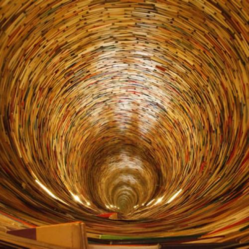 Image of spiraling tunnel of books